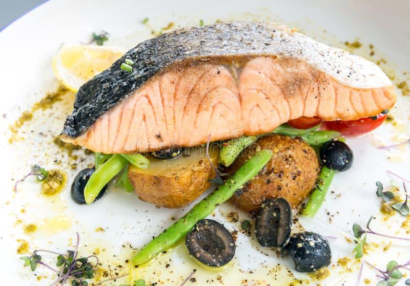 grilled salmon steak pesto stock images
