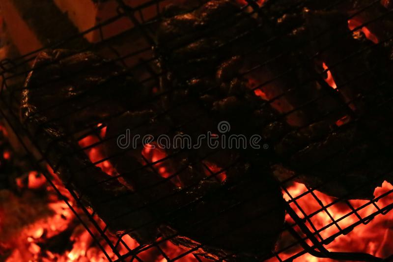 Grilled salmon steaks on a grill. Fire flame grill. Restaurant and garden kitchen. stock image