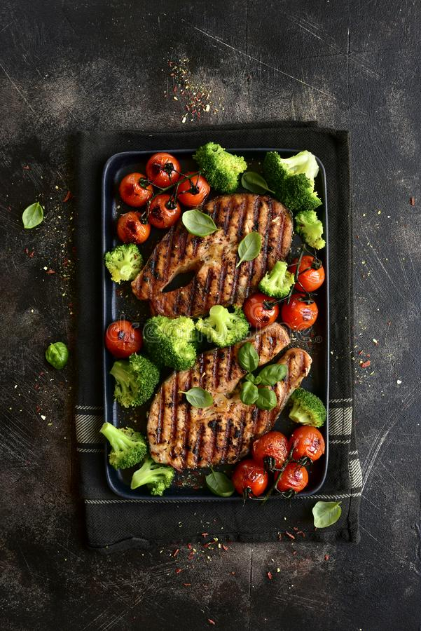 Grilled salmon steaks with vegetables.Top view with copy space stock images