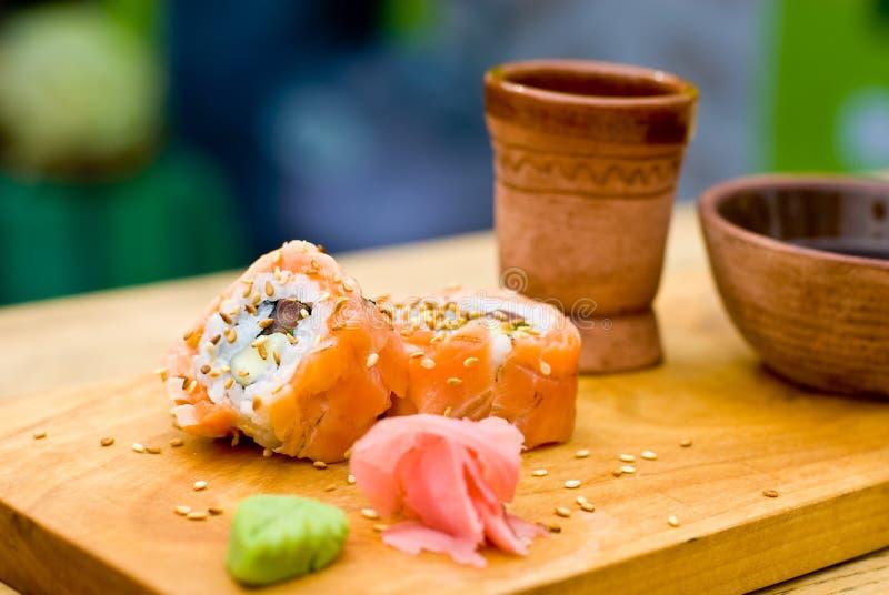 Grilled salmon sushi stock image