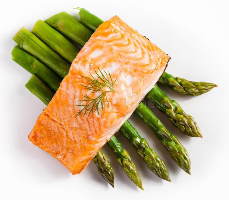 Grilled salmon and vegetables stock image