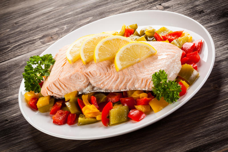Grilled salmon and vegetables. Fish dish - roasted salmon and vegetables stock image