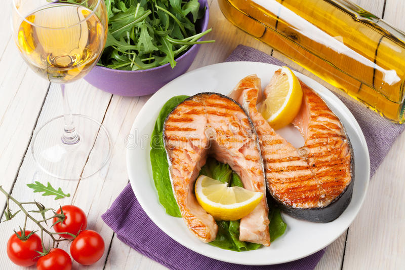 Grilled salmon and whtie wine stock photos