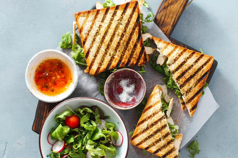 Grilled sandwich chicken wooden board top view healthy breakfast royalty free stock photography
