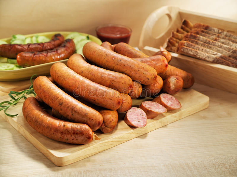 Grilled sausage with bread, cucumber, tomato ke royalty free stock image