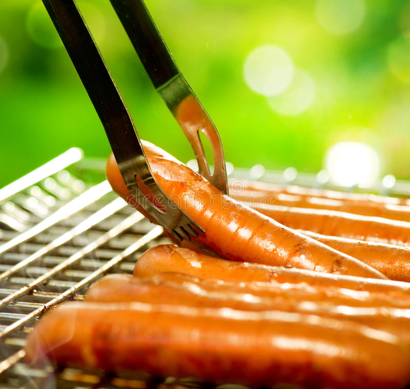 Grilled Sausage on the flaming Grill. BBQ. Bearbeque outdoors royalty free stock photos