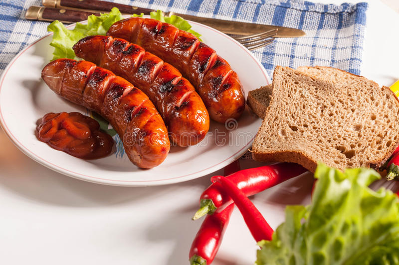 Grilled Sausage. Stock Photo