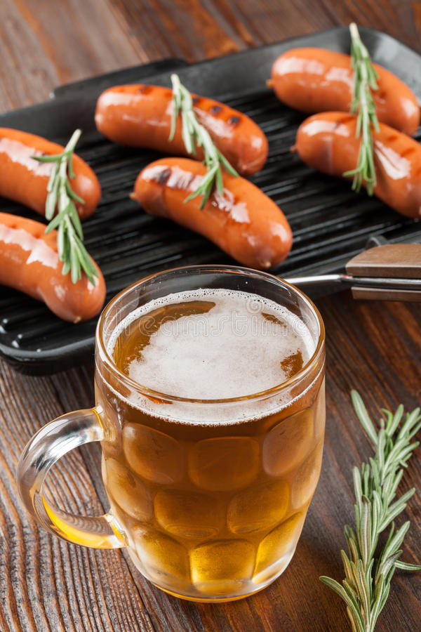 Grilled sausages and beer stock image