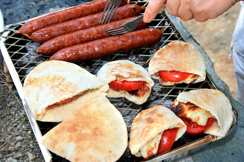Grilled sausages,halloumi cheese, tomato in pita. royalty free stock image
