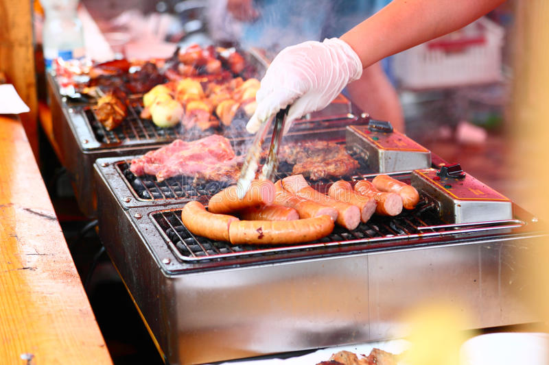 Grilled Sausages And Meat On The Barbecue Stock Photos