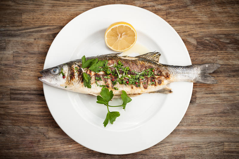 Grilled sea bass. On a plate stock images