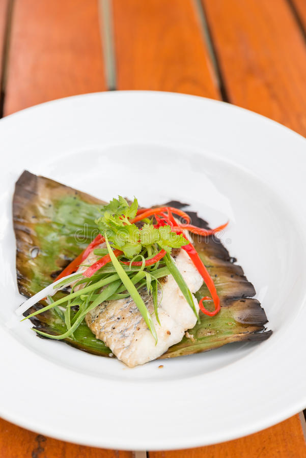 Grilled Sea Bass. Fillet with leek and chili stock images