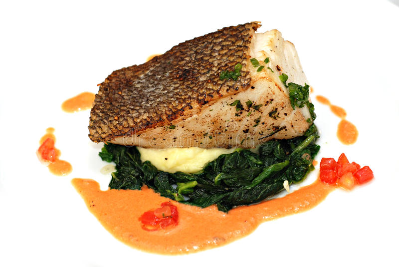 Grilled sea bass steak. With Spinach salad and Mashed potatoes royalty free stock photos
