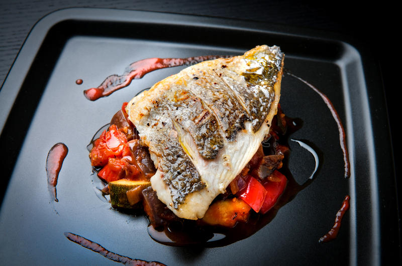 Grilled sea bream fillet stock images