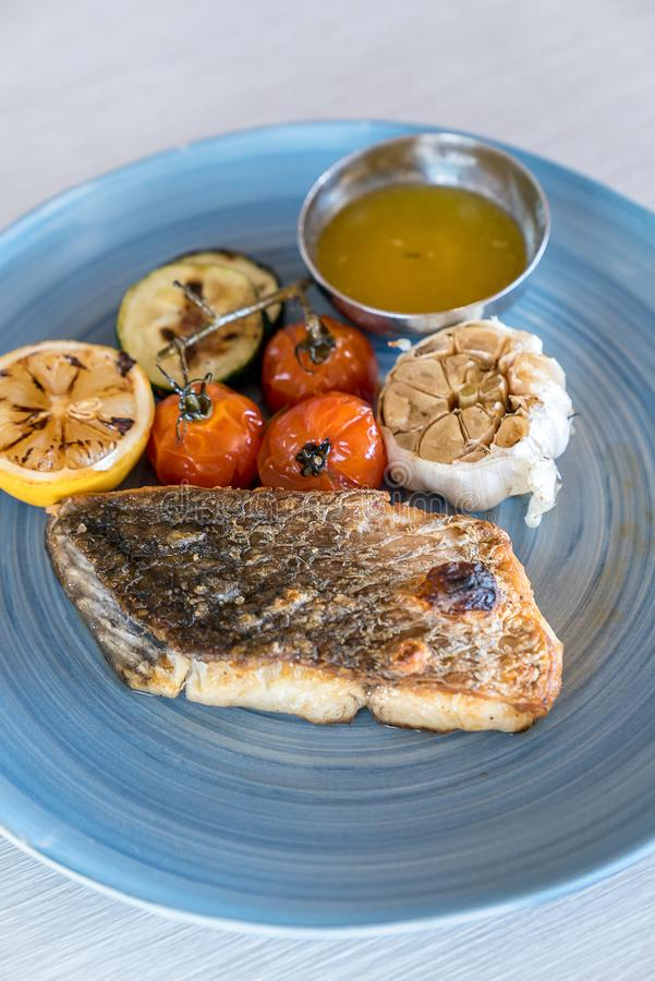 Grilled seabass. Fish  with grilled vegetable royalty free stock photo