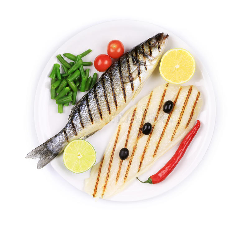 Grilled seabass with pangasius fillet. Isolated on a white background stock photography