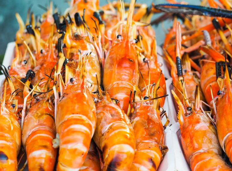 Grilled shrimp for sale on street market. Fresh barbecue prawns in seafood market. royalty free stock photography