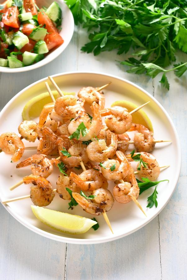 Grilled shrimp skewers stock images