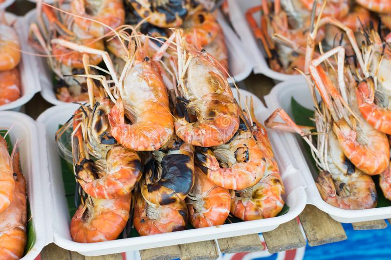 Grilled shrimps on the dish, seafood on street foods market stock photo