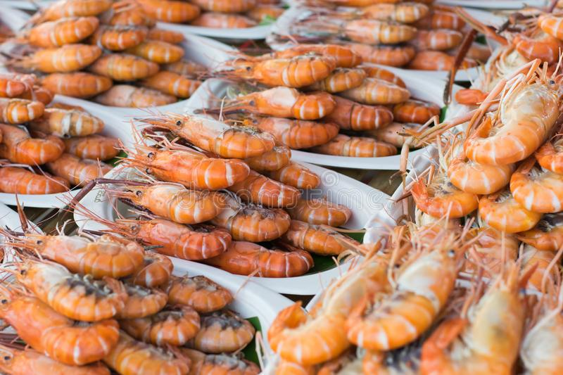 Grilled shrimps on the dish, seafood on street foods market.  stock image