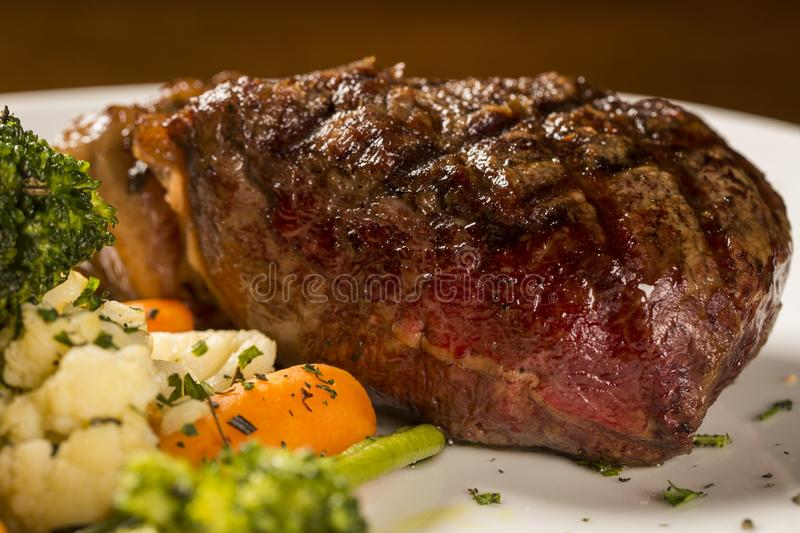 Grilled sirloin steak with grilled vegetables royalty free stock photo