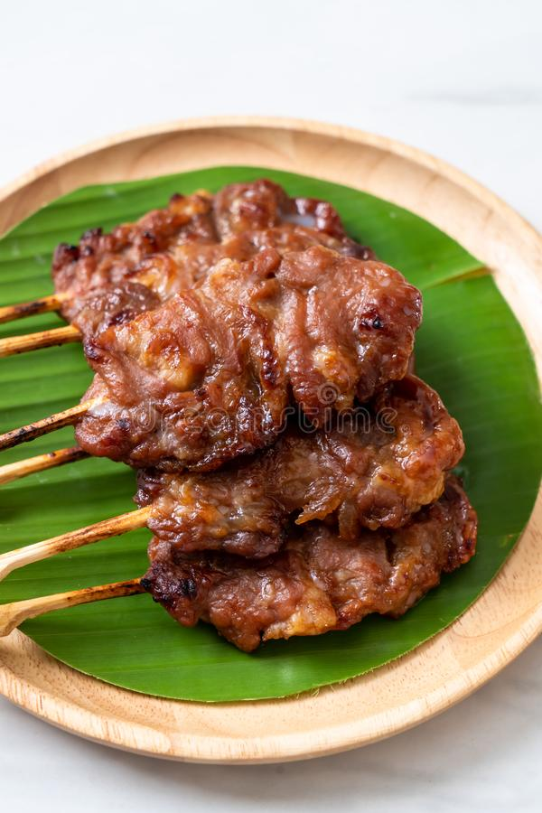 grilled skewered milk pork with white sticky rice royalty free stock photos