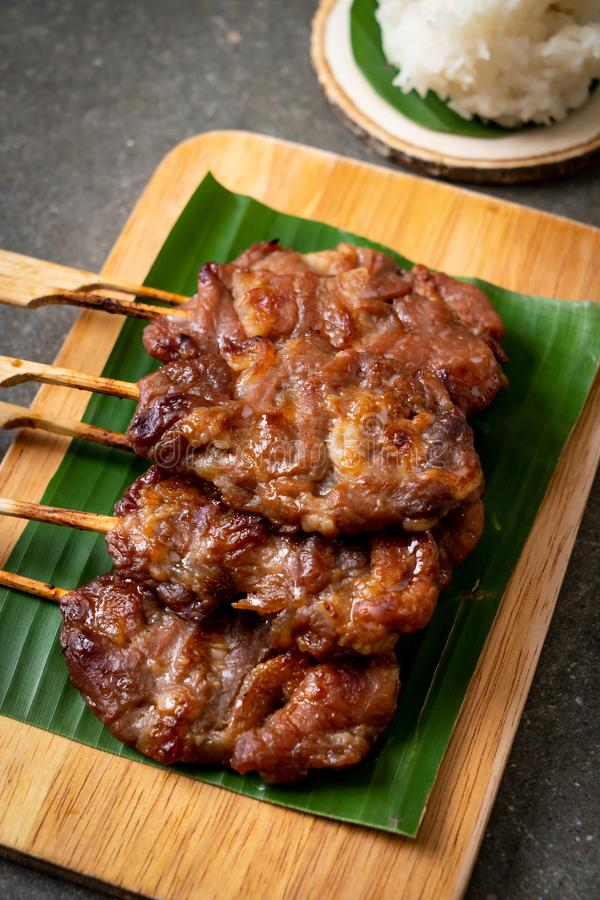 grilled skewered milk pork with white sticky rice stock image