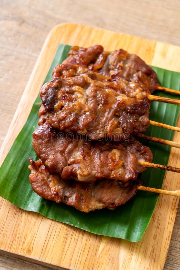 grilled skewered milk pork with white sticky rice royalty free stock photo