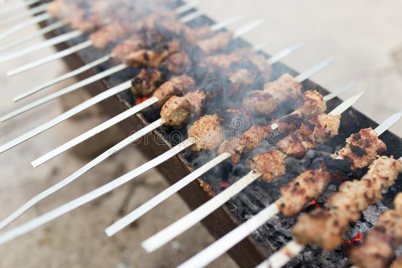 Grilled skewers on the grill stock photos