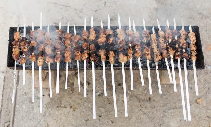 Grilled skewers on the grill royalty free stock images