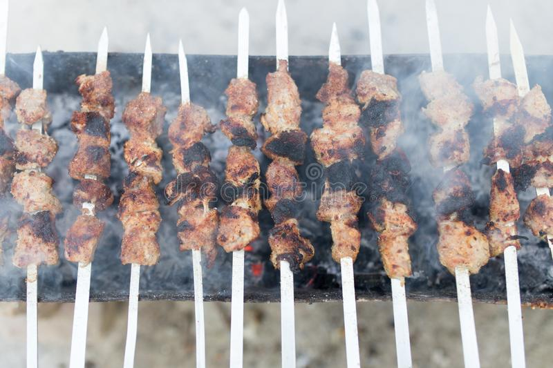 Grilled skewers on the grill royalty free stock photos