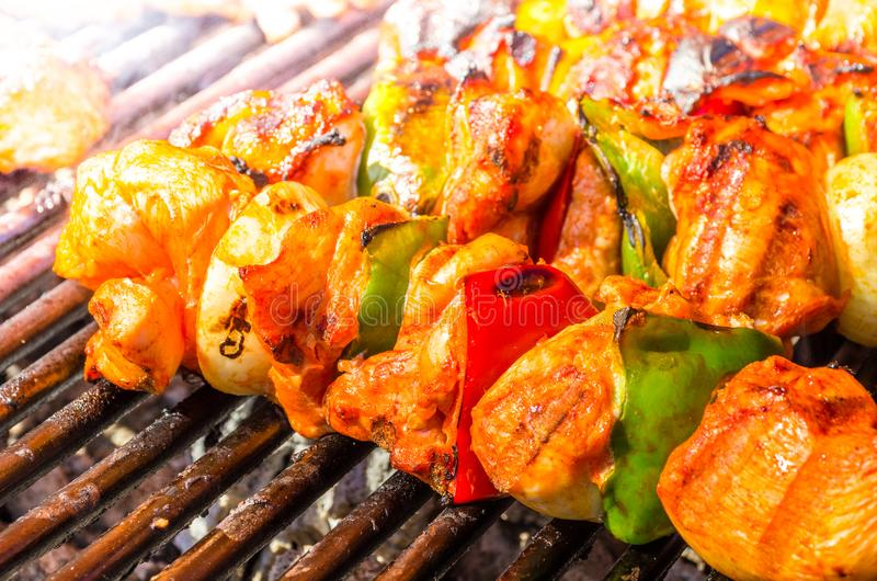 Grilled skewers of vegetables and meat on the grill royalty free stock photo