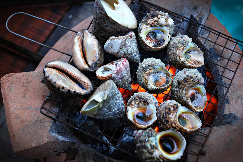 Grilled snails royalty free stock photos
