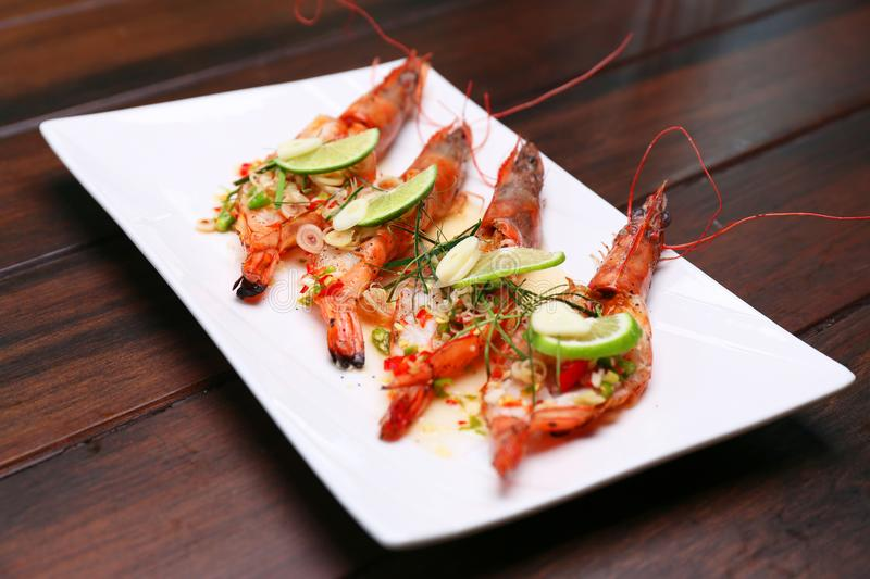 Grilled Spicy River Prawn with lime garlic and lemongrass, Selective focus royalty free stock image