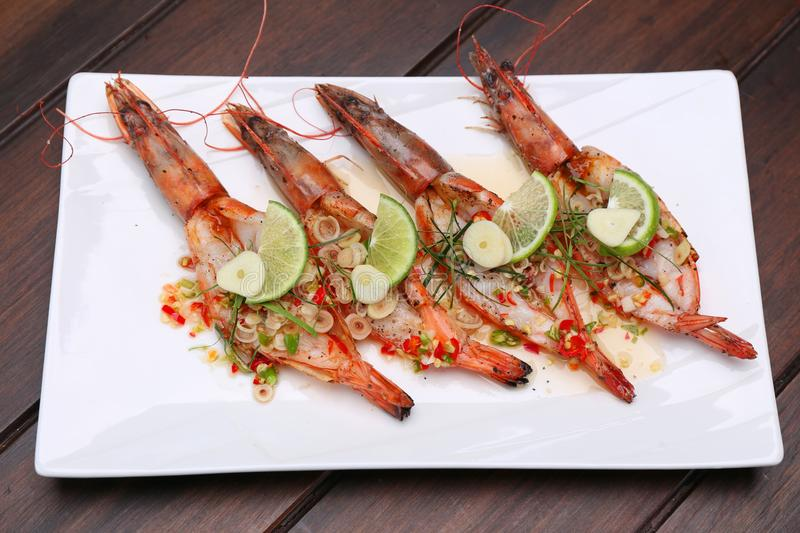 Grilled Spicy River Prawn with lime garlic and lemongrass on woo stock image