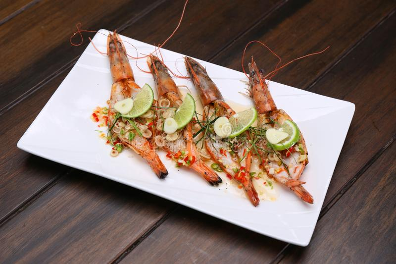 Grilled Spicy River Prawn with lime garlic and lemongrass on woo stock photo