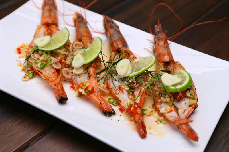 Grilled Spicy River Prawn with lime garlic and lemongrass on woo royalty free stock image