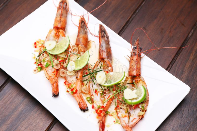 Grilled Spicy River Prawn with lime garlic and lemongrass on woo royalty free stock photo