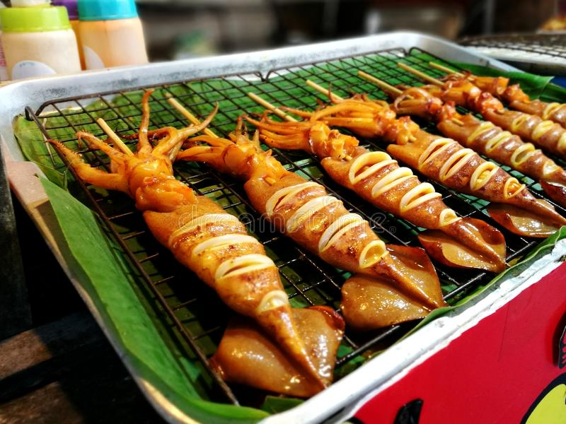 Grilled squid stock images