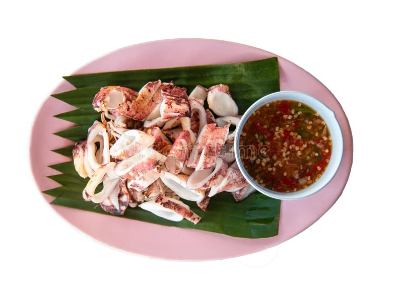 Grilled squid slice on plate banana leaf isolated white background stock images