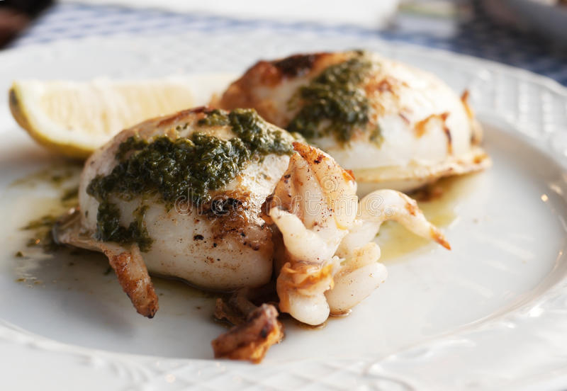 Grilled squid with special Canarian sauce mojo stock images
