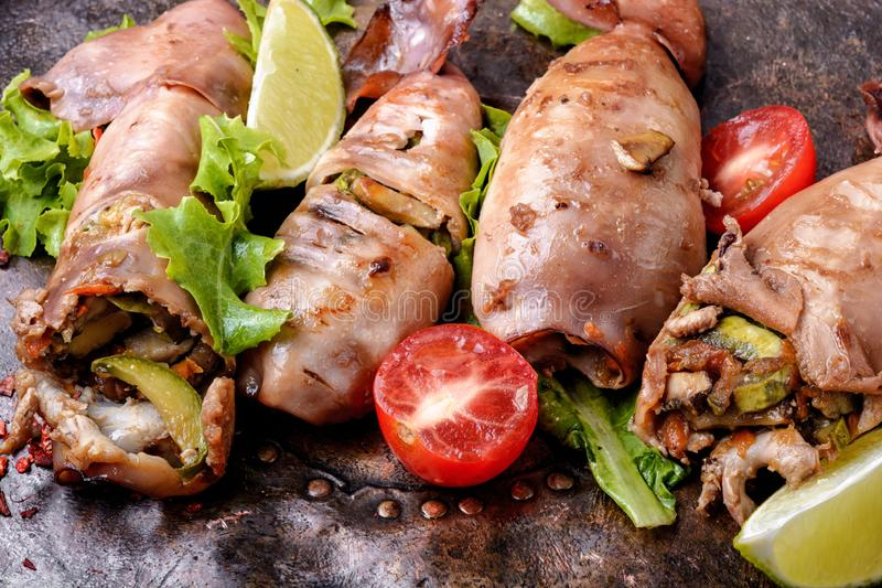 Grilled squid with vegetables royalty free stock photos