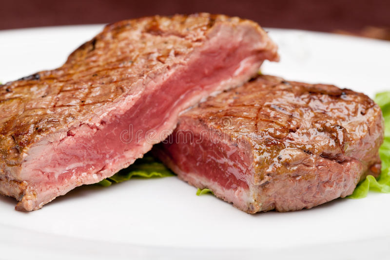Grilled steak. Chargrilled to medium rare stock image