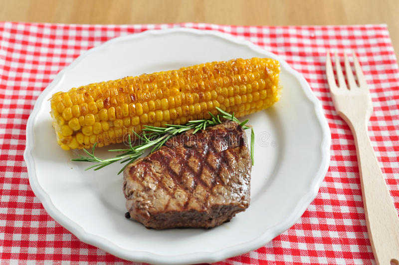 Grilled steak with corn royalty free stock images