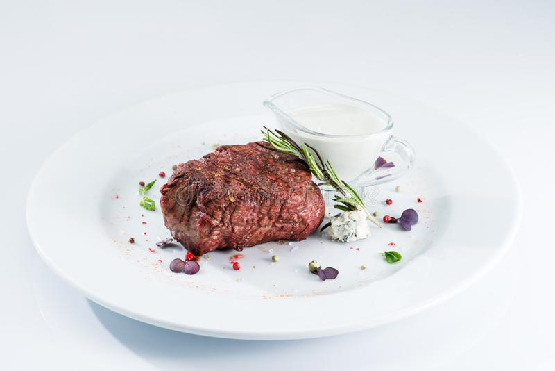 Grilled steak delicious beef meat. On a white plate on a light background menu stock photos