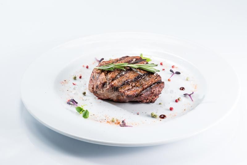 Grilled steak delicious beef meat. On a white plate on a light background menu stock images