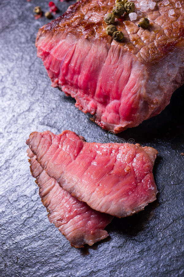 Grilled steak. A fresh and tasty grilled steak stock photo