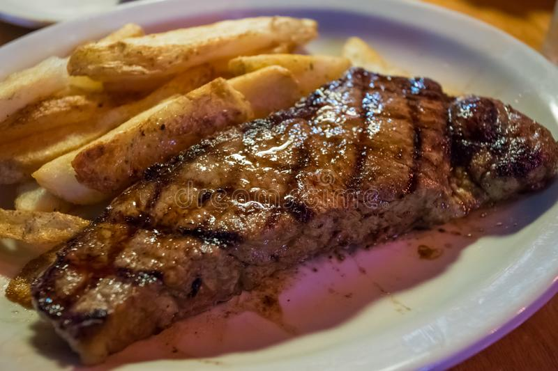 Grilled Steak and Fries Dinner royalty free stock photos