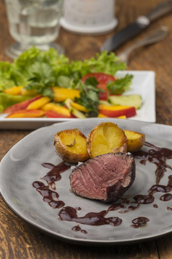 Grilled steak on a plate royalty free stock photo