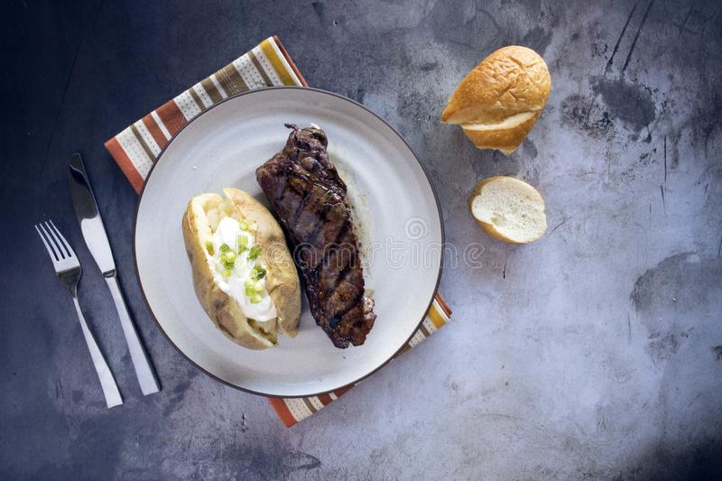 Grilled Steak and Loaded Baked Potato royalty free stock image
